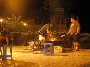 Grilling veal for the food trucks on the Papeete waterfront, Tahiti, 2007